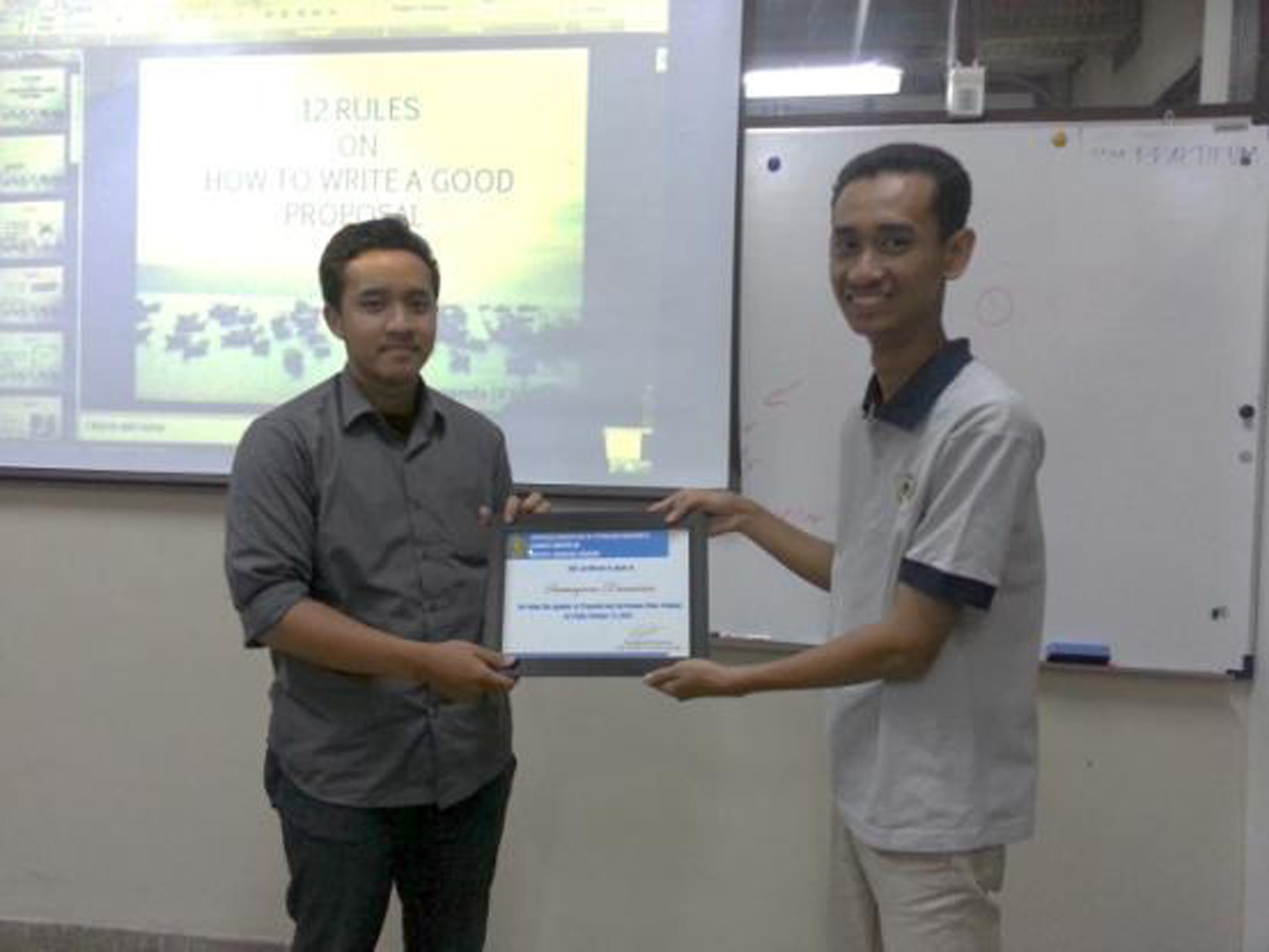 SawungronoDewawisesa (Left) was given a certificate also from IwanSetiawan as the project officer (right).